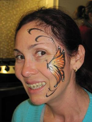 A Lovely Butterfly on an even Lovelier Lady