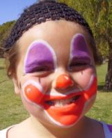smiling clown face painting design