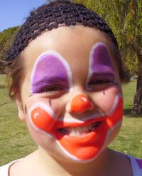 Smiling clown face painting
