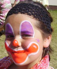 smiling clown face painting step 3