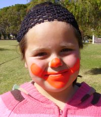 smiling clown face painting step 1